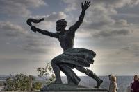 Statue am Fuß der Freiheitsstatue